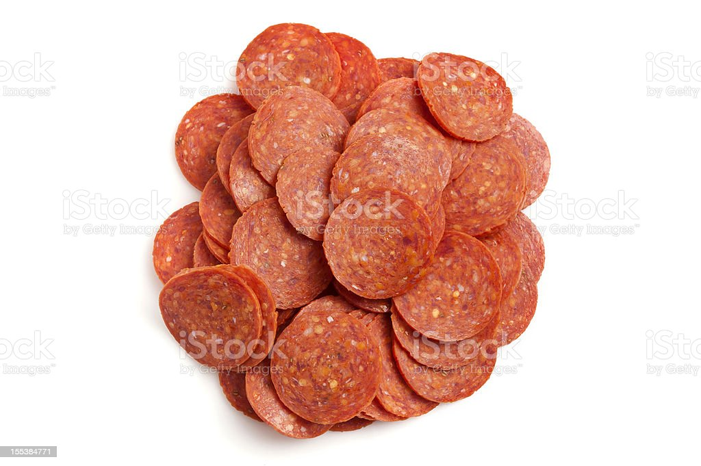 Heap of pepperoni stock photo