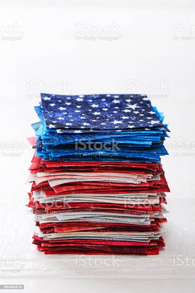 Heap of pieces of patchwork fabrics ordered like USA flag stock photo