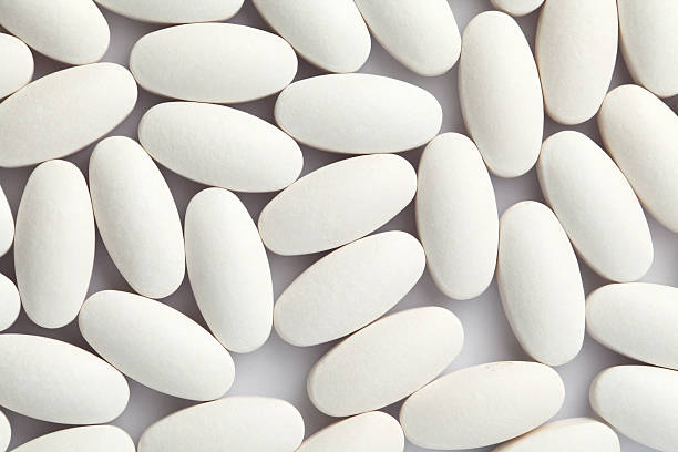 Royalty Free White Oval Pill Pictures Images And Stock Photos Istock