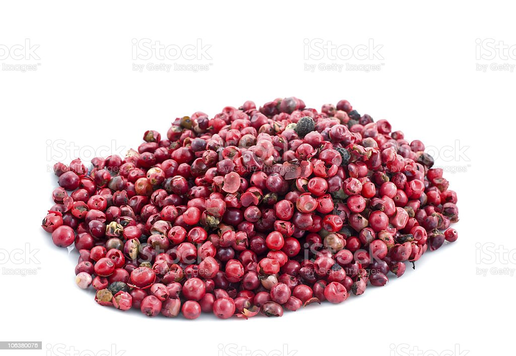 heap of pink pepper in corns stock photo