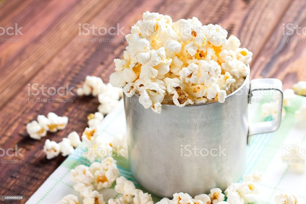 Heap of popcorn in aluminum cup stock photo