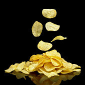 Many potato chips with falling chips