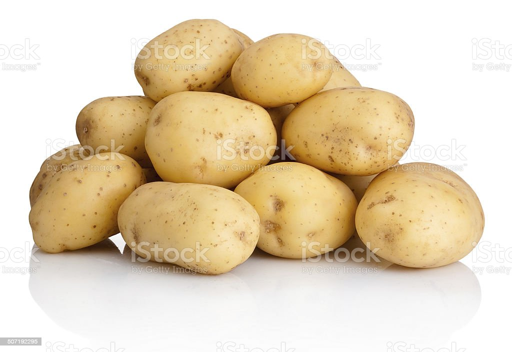 Heap of potatoes isolated on white background stock photo