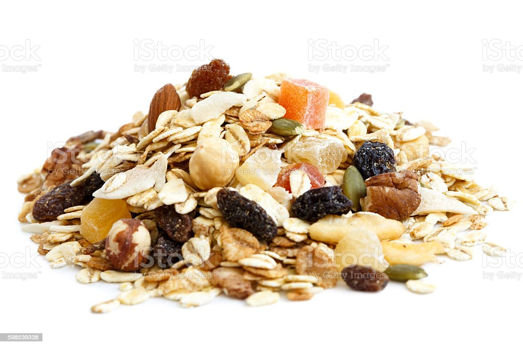 Heap of premium fruit and nut muesli isolated on white. photo libre de droits