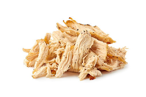 Heap of pulled chicken meat isolated on white background. Clipping path included
