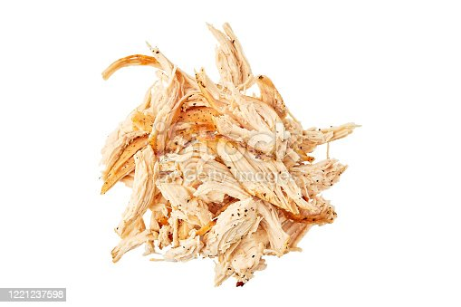 Heap of pulled chicken meat isolated on white background. Top view, clipping path included