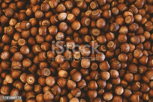 heap of raw hazelnut in shell close-up