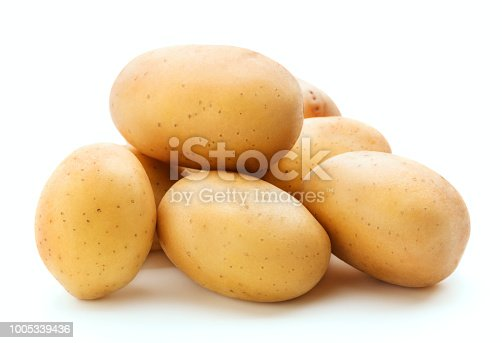 heap of fresh raw potato isolated on white background