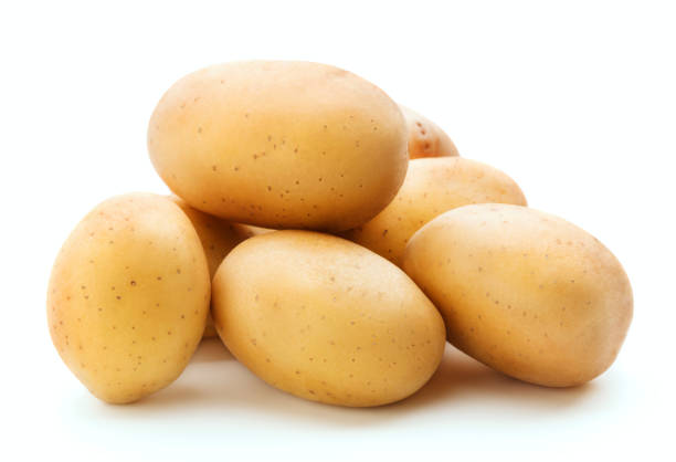 heap of raw potato stock photo