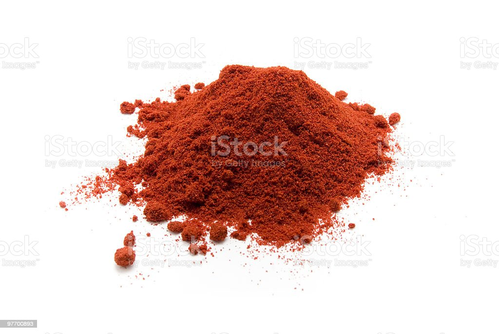 Heap of red paprika powder on a white background stock photo
