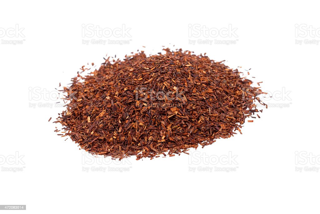 Heap of red rooibos traditional organic tea on white isolated stock photo