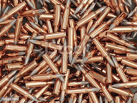1043434568 istock photo Heap of Rifle Bullet isolated on white background 532687959