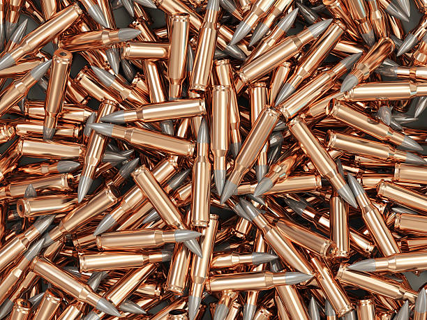 Heap of Rifle Bullet isolated on white background stock photo