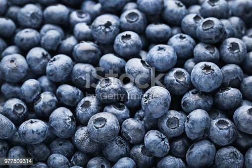 Heap of ripe and sweet blueberries background