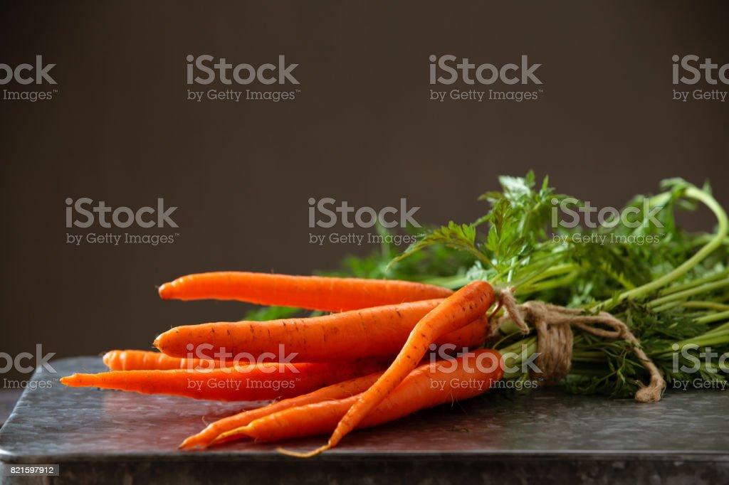 Heap of ripe carrots. stock photo