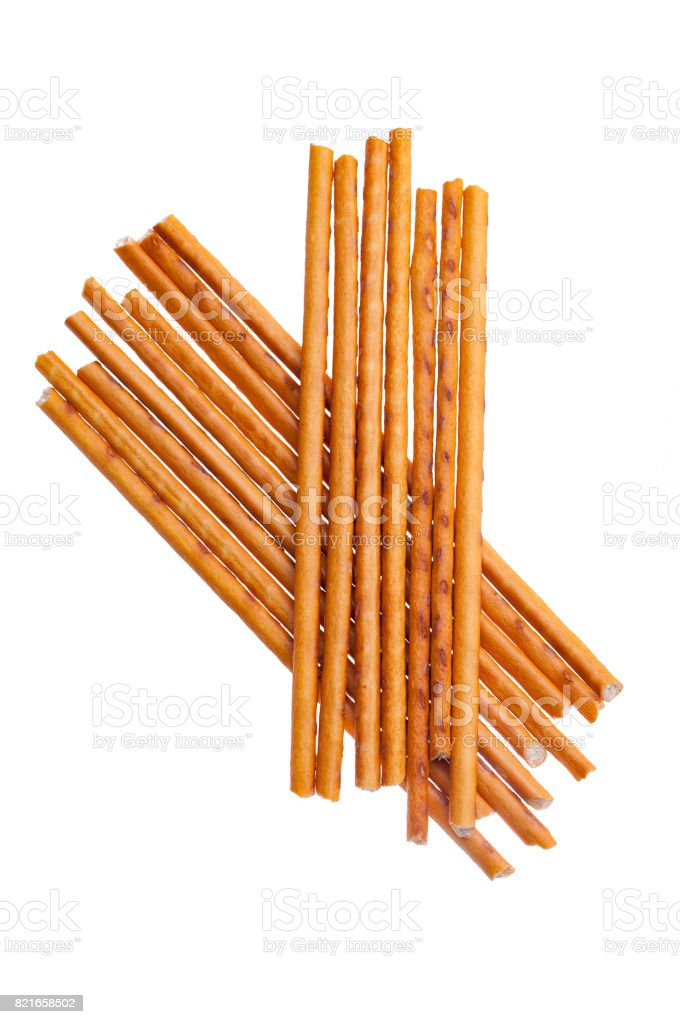 Heap of salty bread sticks isolated on white background stock photo