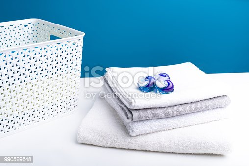 istock Heap of soft washed laundry with detergent on top 990569548