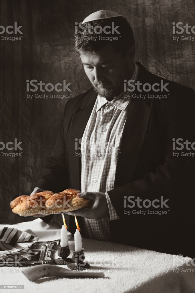Heap of sweet round sabbath challah bread with stock photo