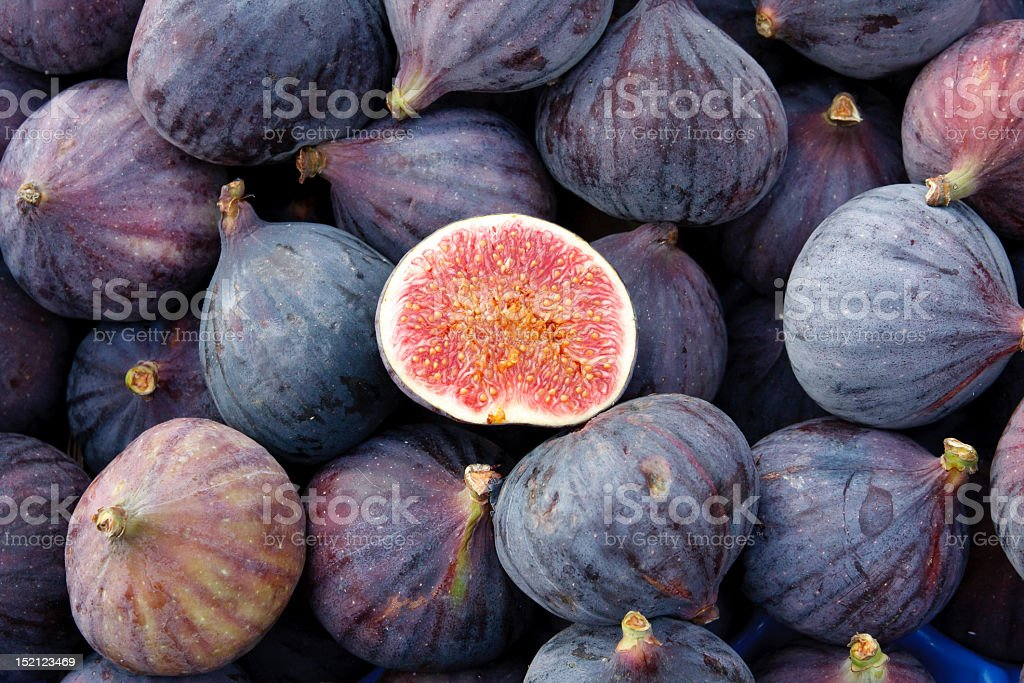 Heap of tasty organic figs at local farmers market stock photo