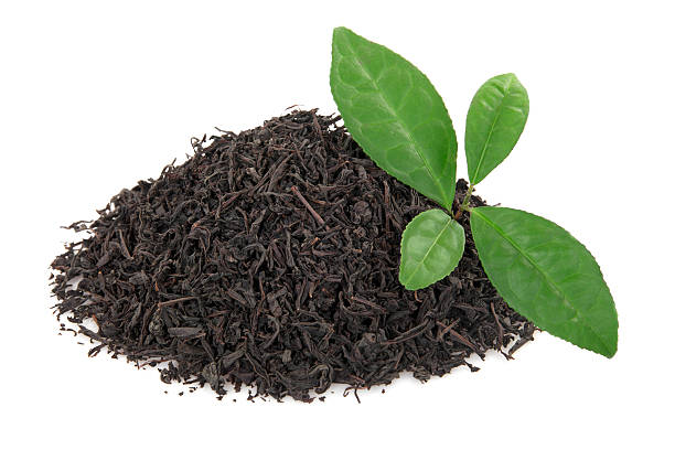 heap of tea leaves - tea leaf stock photos and pictures
