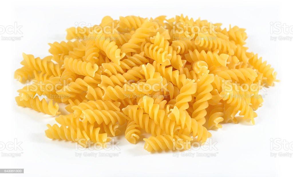 Heap of uncooked italian pasta fusilli on a white stock photo