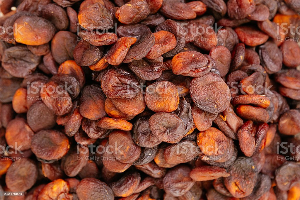 Heap of very dried apricots background - Photo