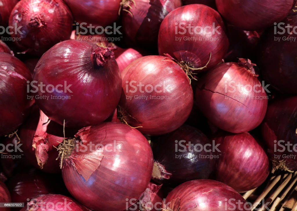 Heap of Vibrant Color Fresh Red Onions in the Basket, Thailand stock photo