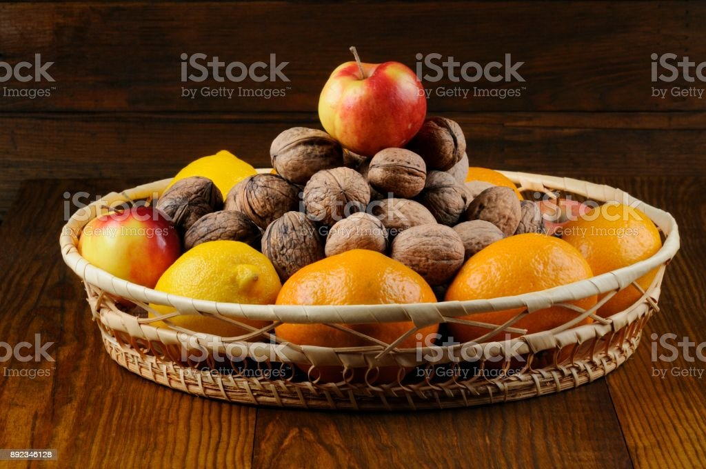 Heap of Walnuts and Apple stock photo