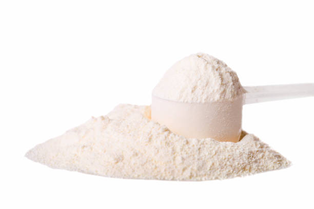 Heap of white protein powder with measuring spoon Heap of white protein powder with measuring spoon isolated on white background. handful stock pictures, royalty-free photos & images