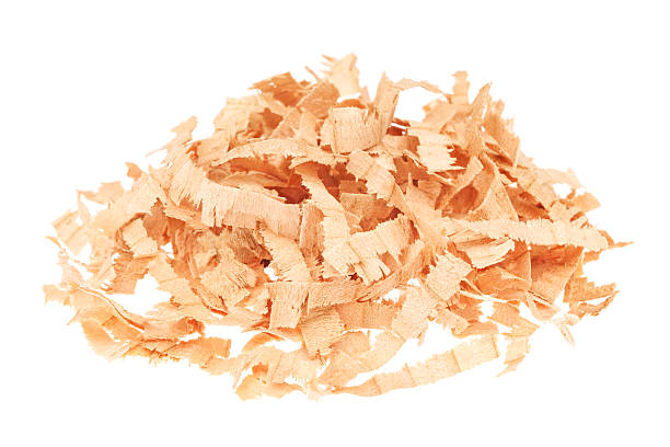 Heap of wood shavings isolated on white stock photo