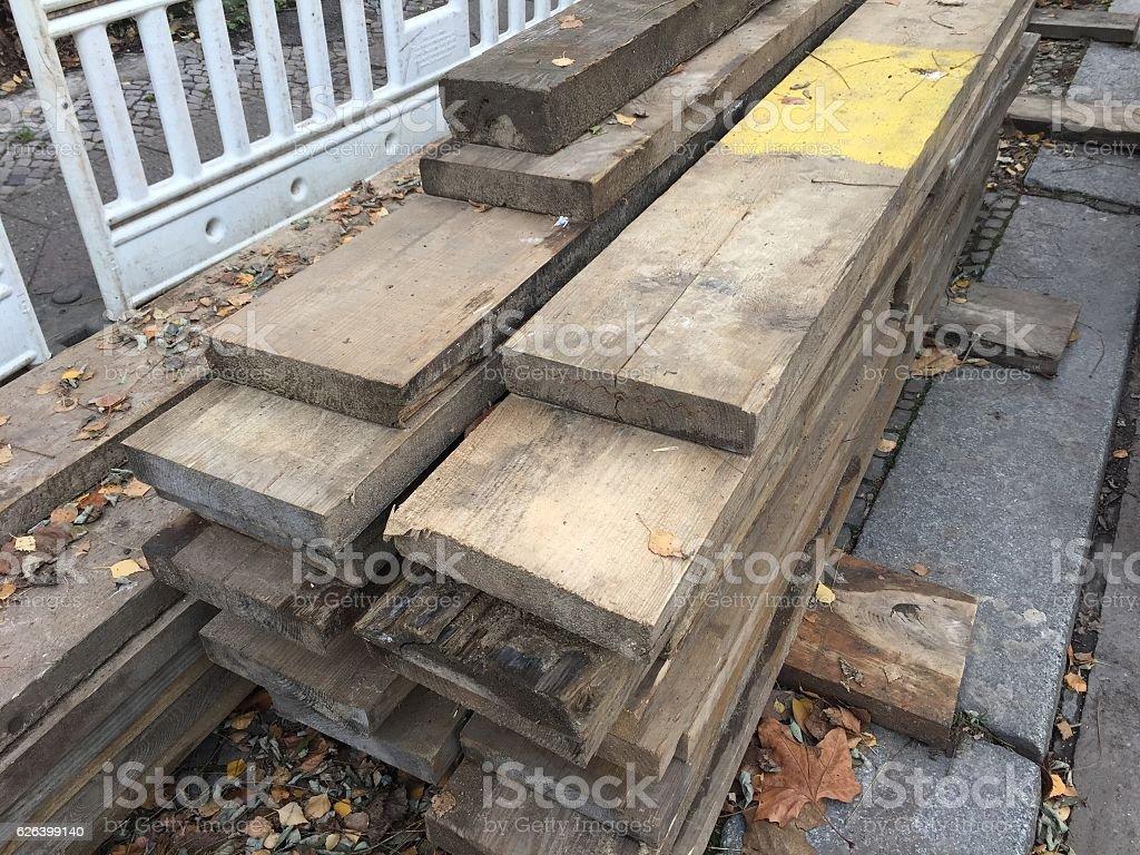Heap of wooden beams stock photo