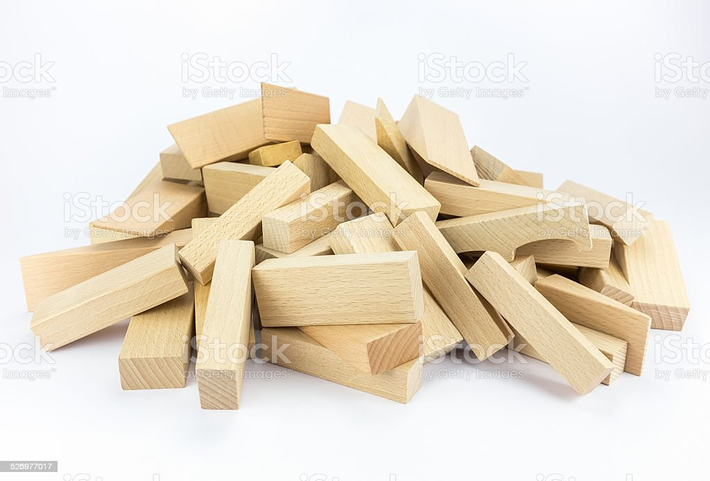 Heap of wooden building blocks stock photo