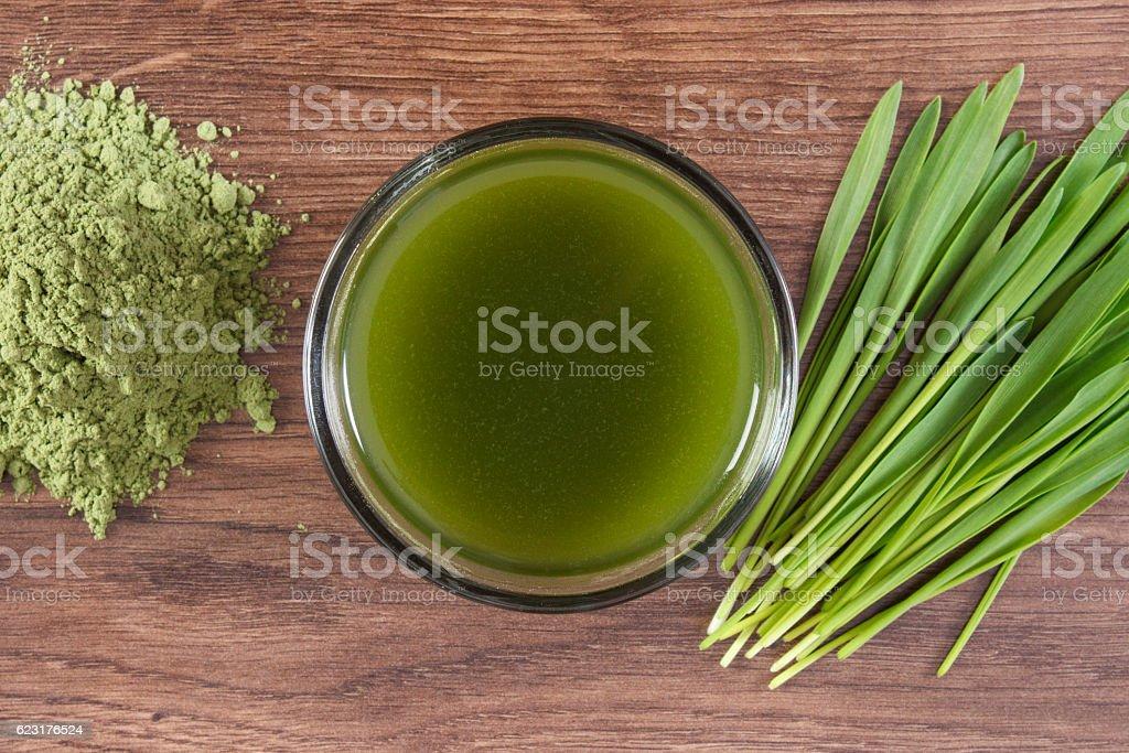 Heap of young powder barley, barley grass and beverage stock photo