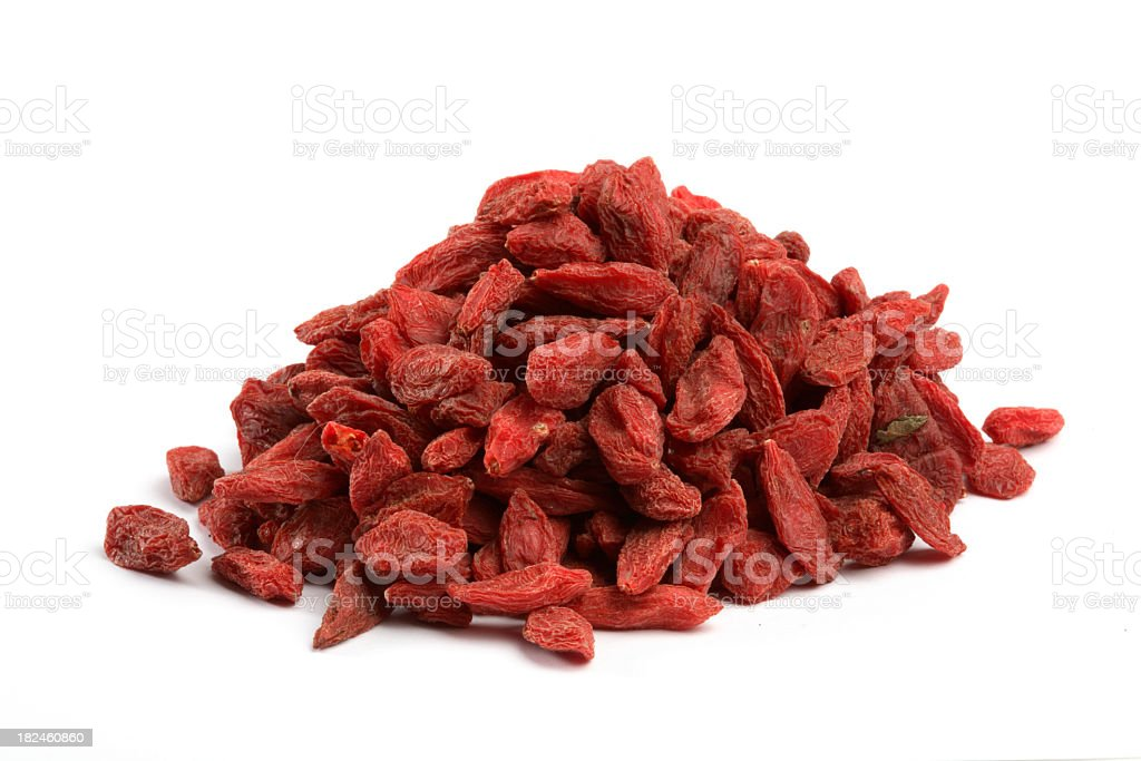 Heaping pile of dried Goji berries on white background stock photo