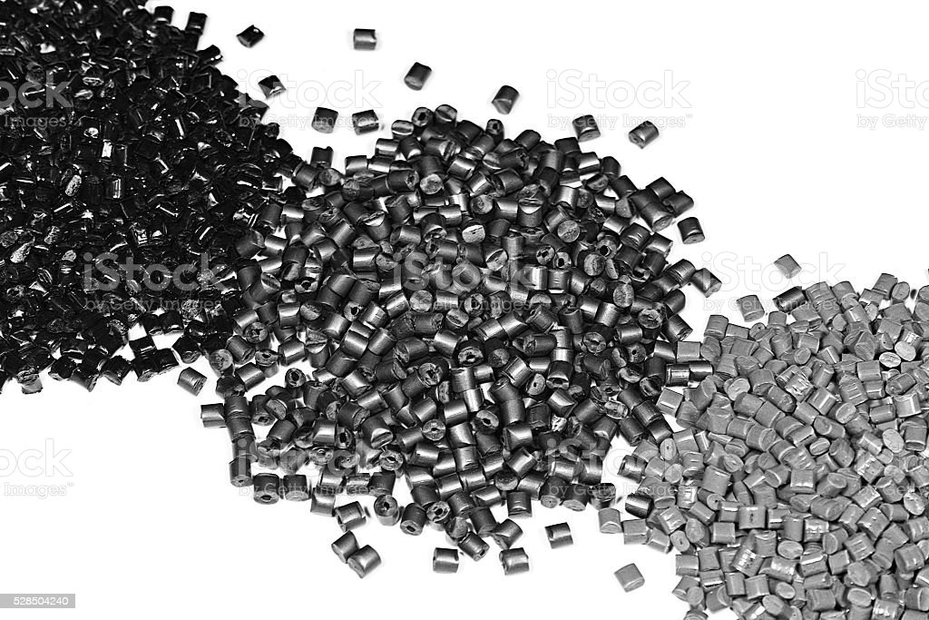 heaps of gray polymer resin stock photo