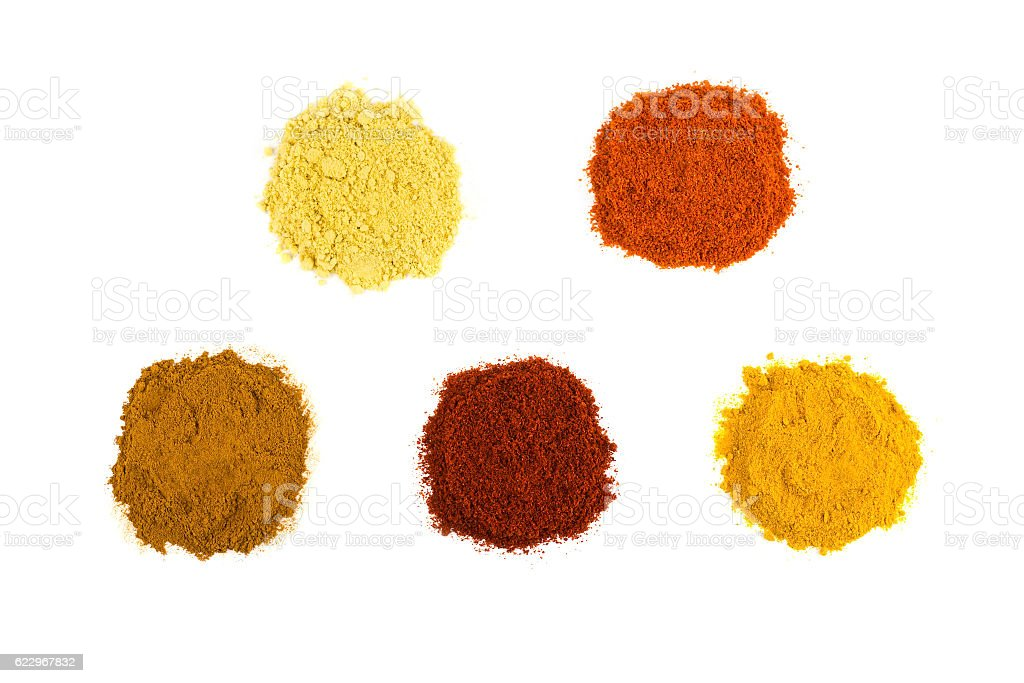 Heaps of various seasoning spices on white stock photo