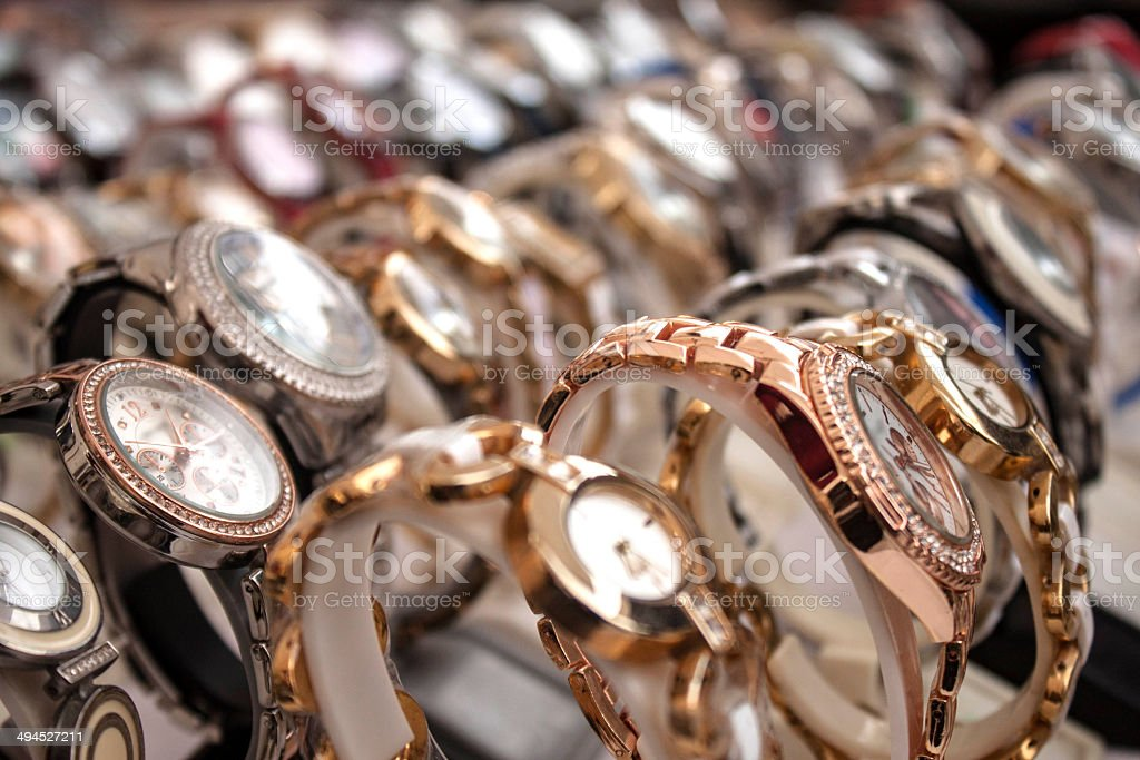 Heaps of wristwatches background stock photo