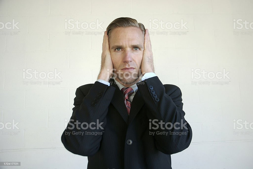 Hear No Evil Businessman Covering Ears stock photo