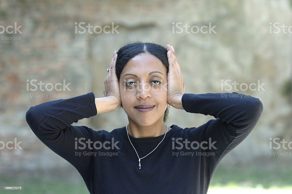 Hear no evil black female with hands on her ears African Ethnicity Stock Photo