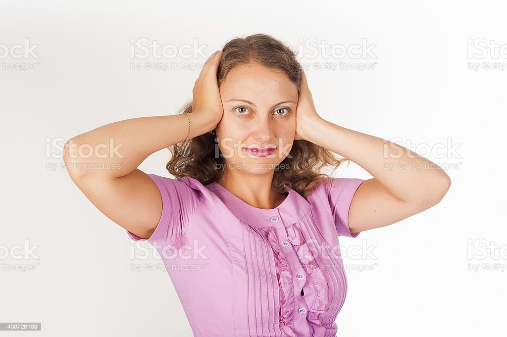 Hear no evil - Young woman covering her ears royalty-free stock photo
