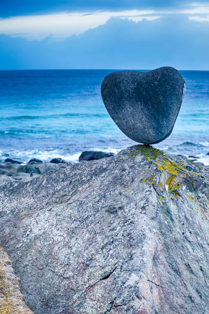 Hear Shaped Stone at Uttakliev Beach on Lofoten Islands in Norway. Vertical Image Composition