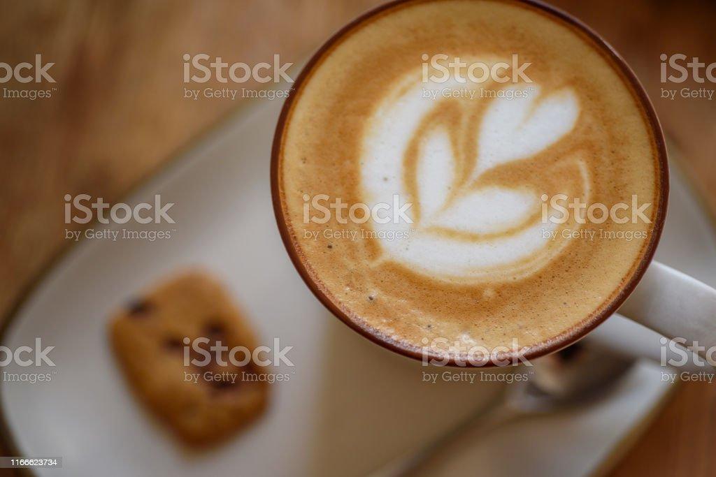 Hearg shape coffee art on while tray