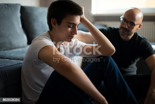 Upset young man talking with his father.