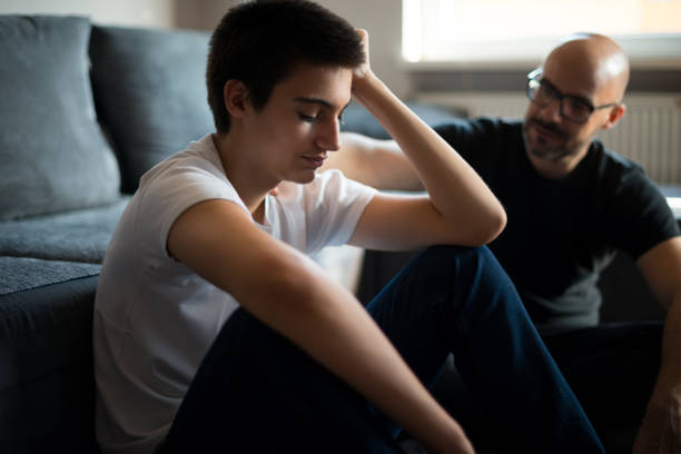 hearing a father's advice - ragazzi adolescenti foto e immagini stock