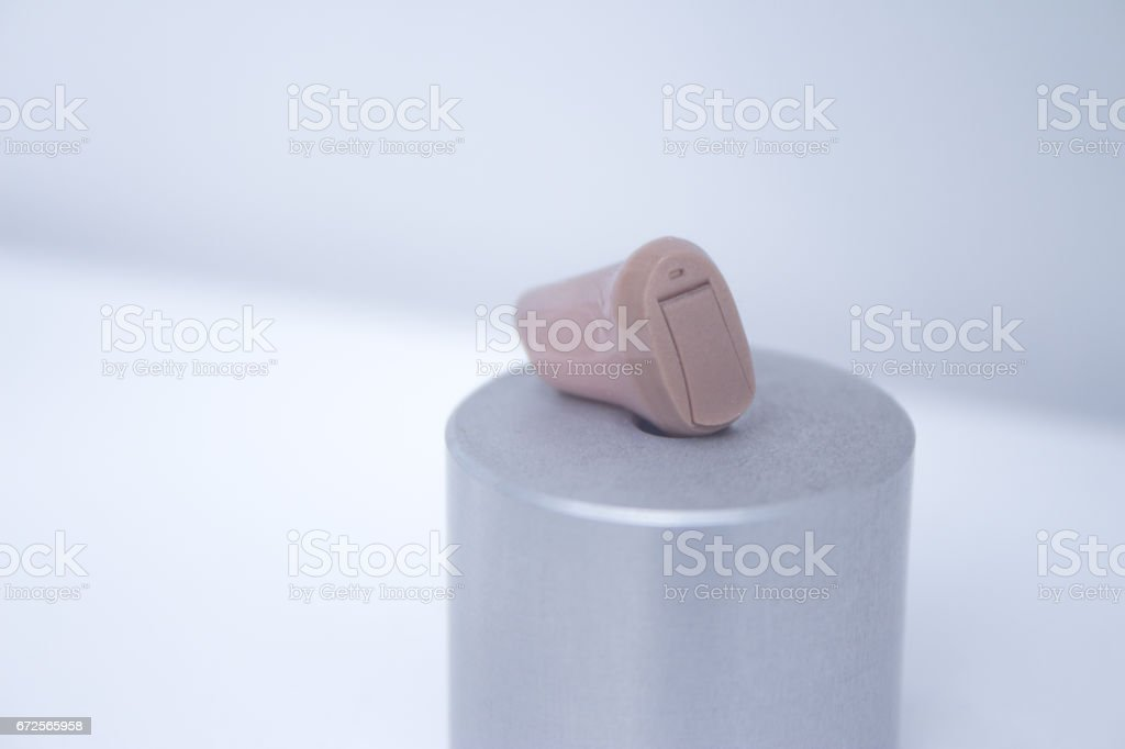 Hearing aid for people with reduced hearing stock photo