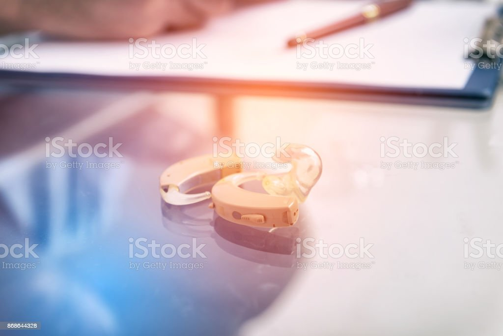 Hearing aid on desktop stock photo