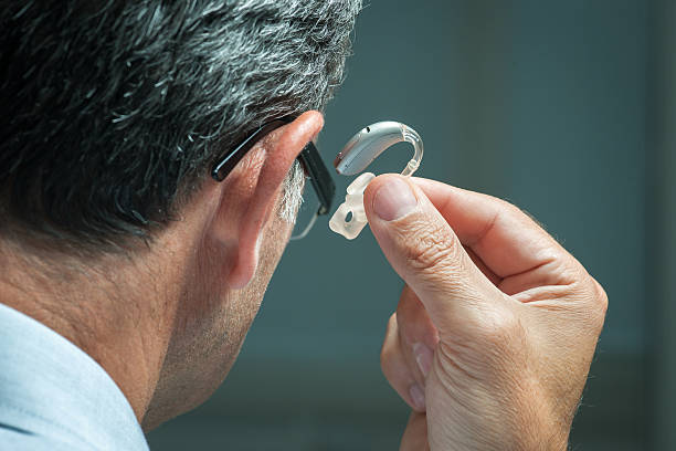 hearing aid - hearing loss stock pictures, royalty-free photos & images