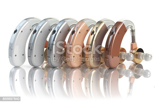 istock Hearing aids of the different colors isolated on white background. Deaf ear aid. 3d 835997840