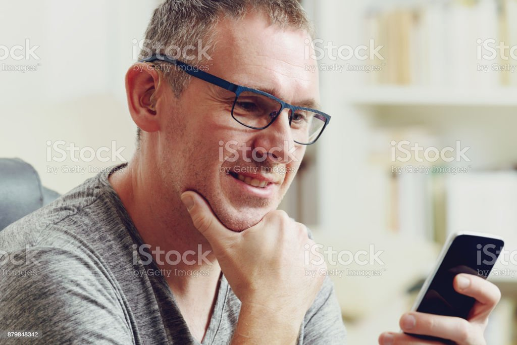 Hearing impaired man with hearing aid - foto stock