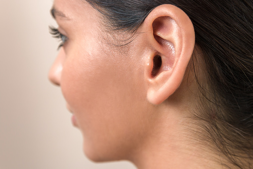 hearing problems. close up ear of a young woman. women hear everything.